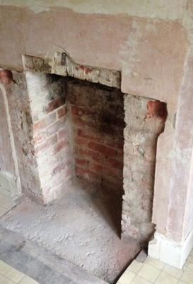 Plastering around fireplace