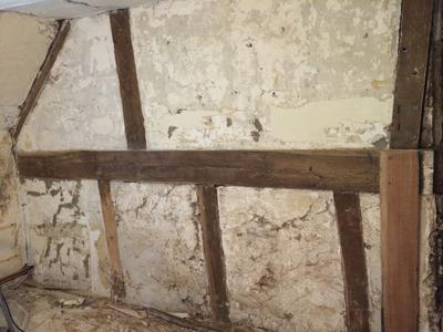 restoring and old bedroom wall